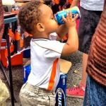Young Cleveland Browns Fan Drinking Beer